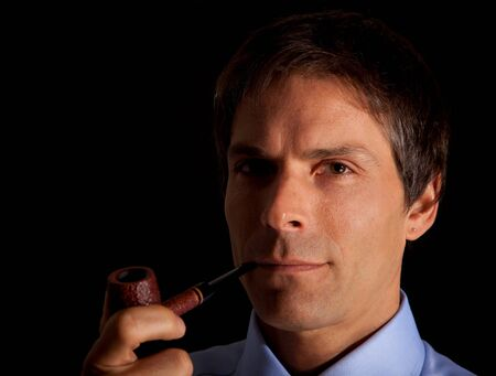succesful: Portrait of a succesful executive smoking a pipe