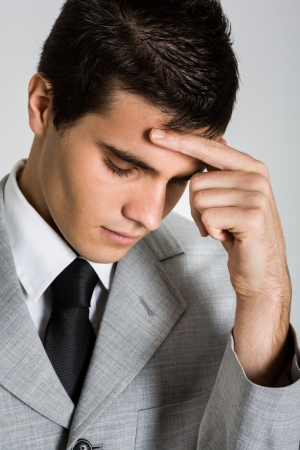Portrait of a young depressed businessman photo