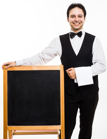 Professional waiter showing an empty blackboard photo