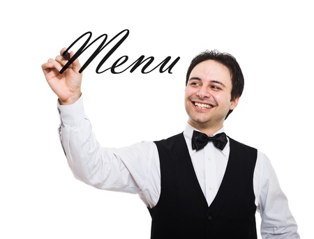 busboy: Portrait of a smiling waiter writing Menu on the screen