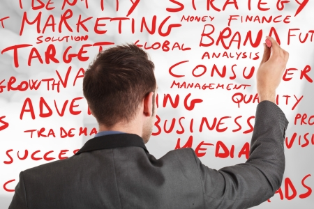 Businessman writing business concepts photo