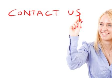 write us: Beautiful girl writing  contact us  on the screen Stock Photo