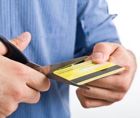 Man cutting a credit card Stock Photo - 15216679