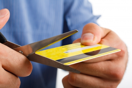 bankrupt: Man cutting up a credit card Stock Photo