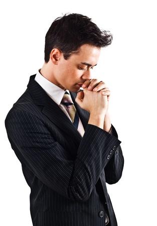 hombre orando: Hombre de negocios joven guapo oración Foto de archivo