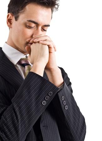 hombre orando: Hombre de negocios joven guapo oraci�n Foto de archivo