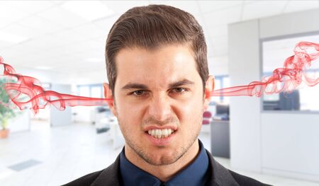 nasty: Angry frustrated businessman with exploding head Stock Photo