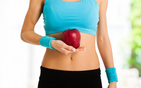 girl belly: Woman holding a red apple Stock Photo