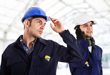 chemical engineering: Two engineers working in a construction site Stock Photo