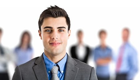 Portrait of an handsome businessman in front of his working team Stock Photo - 15216783