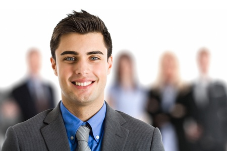 Portrait of an handsome businessman in front of his working team Stock Photo - 15216771