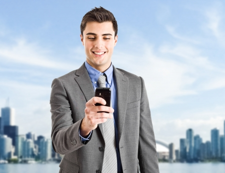 Handsome businessman using his cell phone photo