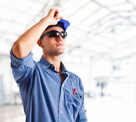 service engineer: Engineer looking at something in a construction site