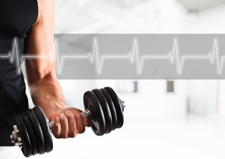 cardio fitness: Powerful muscular man lifting weights Stock Photo