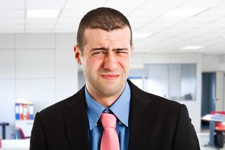 bellyache: Portrait of a suffering businessman