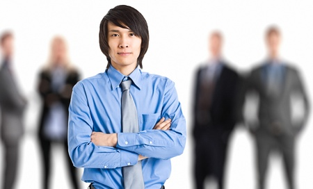 Portrait of an oriental businessman in front of his working team photo