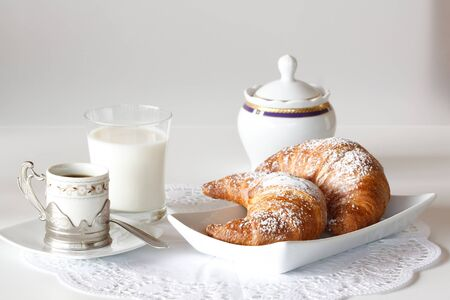 Continental breakfast with coffee, milk and croissants served on a table Stock Photo - 15216721