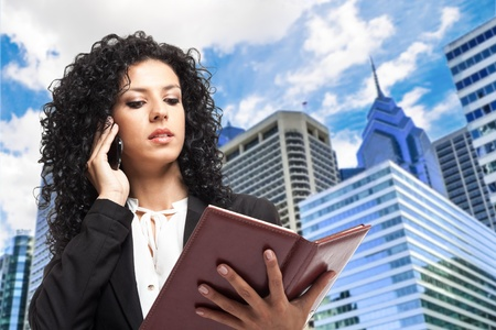 Portrait of a busy businesswoman checking her agenda Stock Photo - 15271416