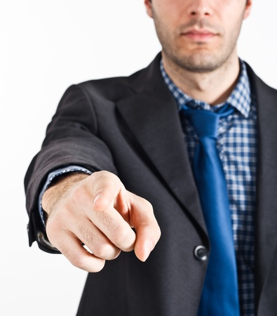 incriminate: Portrait of a businessman pointing his finger at you