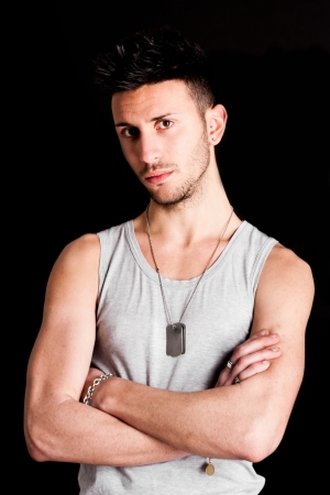 white singlet: Studio portrait of a young handsome model