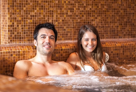 sexy bath: Young couple relaxing in a spa