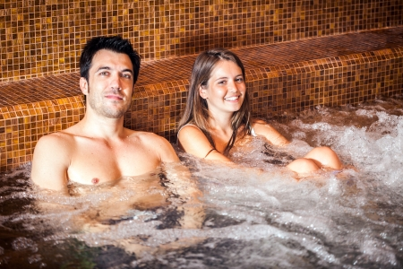 Young couple relaxing in a spa photo