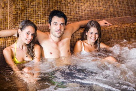 Three friends relaxing in a spa photo