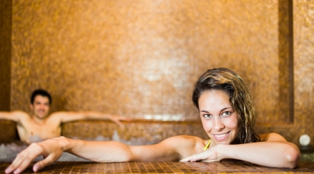 Portrait of a young beautiful woman relaxing in a spa photo