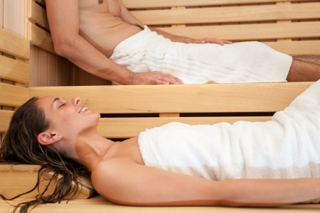 steam bath: Happy couple having a steam bath in a sauna Stock Photo