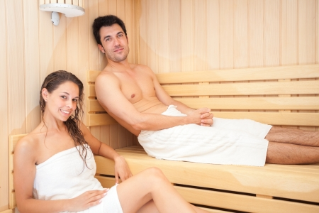 sauna: Happy couple having a steam bath in a sauna Stock Photo