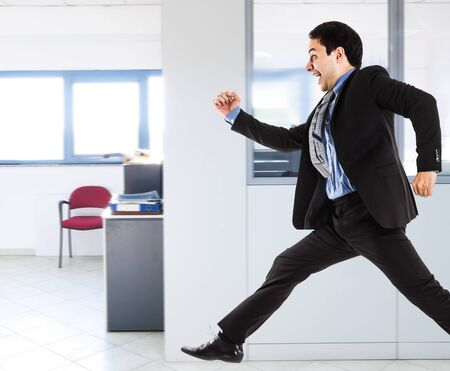 escape: Portrait of an active businessman running in his office