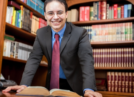 principal: Portrait of a man in front of a book