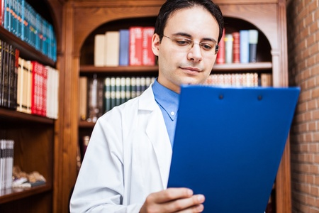 oncologist: Portrait of a successful specialist in his office