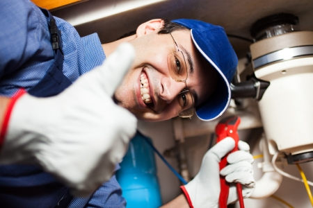 Portrait of a smiling plumber at work photo