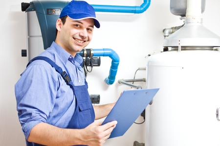 heater: Smiling technician servicing an hot-water heater