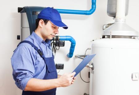 boiler house: Technician servicing an hot-water heater