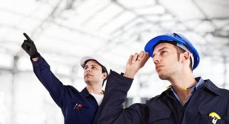ingenieria industrial: Ingenieros en el trabajo Foto de archivo