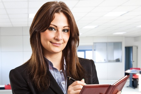 tailleur: Portrait of a young smiling businesswoman Stock Photo