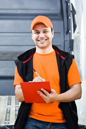 consign: Portrait of an handsome deliverer Stock Photo