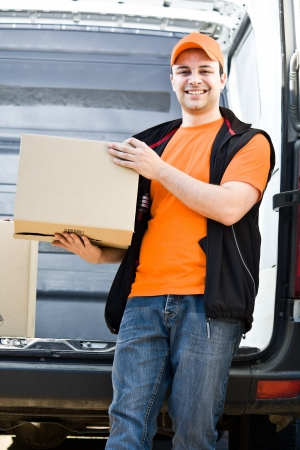 delivery boy: Portrait of an handsome deliverer Stock Photo