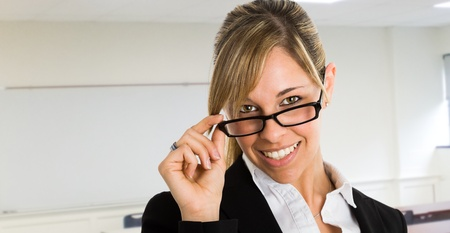 Portrait of a beautiful woman holding her eyeglasses photo