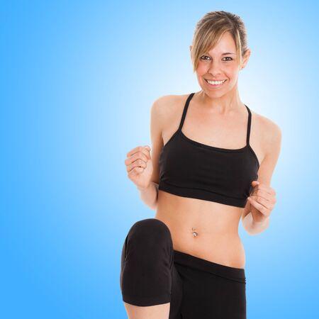 fat burning: Beautiful young woman doing fitness