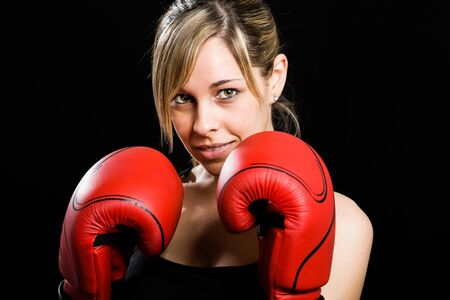 boxing match: Young beautiful female boxer portrait