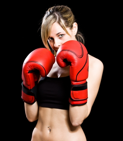 kickboxing: Young beautiful female boxer portrait
