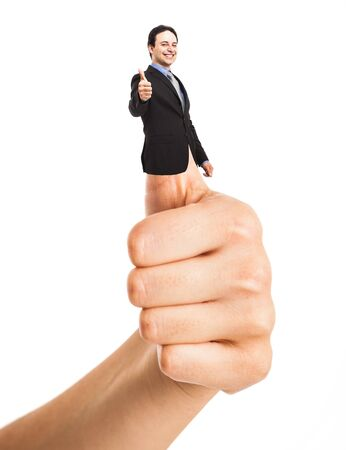 Businessman doing thumbs up photo