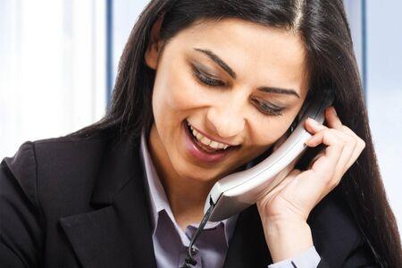 Businesswoman talking on the phone Stock Photo - 15174185