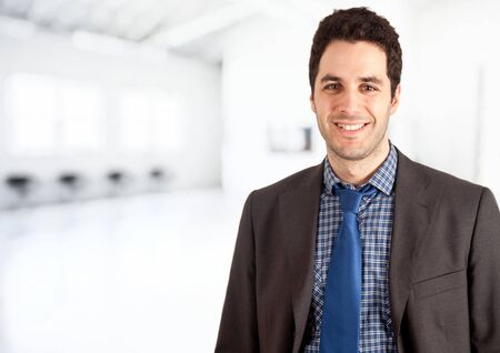 succesful: Portrait of a young succesful businessman in a bright and blurred room.