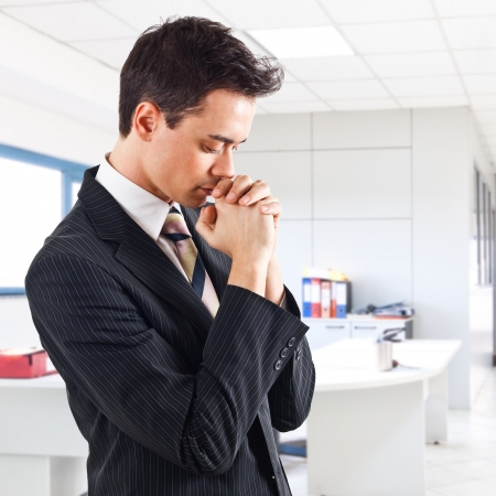 Young handsome business man praying Stock Photo - 15287953
