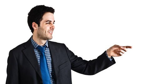 Portrait of a smiling businessman pointing his finger photo