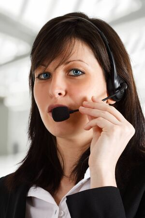 Friendly female phone operator helping a customer. Stock Photo - 15288029